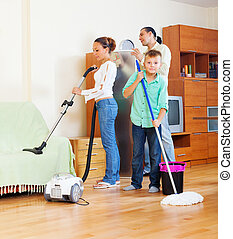 family with cleaning equipment - ordinary family of three...