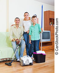 Family of three finished cleaning - Weary family of three...