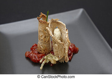 Snack of bread, cheese, red pepper and tempura. Horizontal