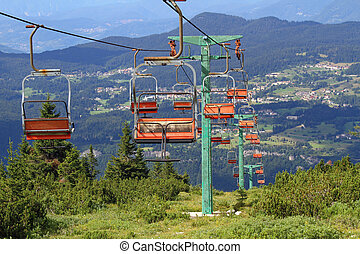 long mountain chairlift in summer - mountain chairlift in...