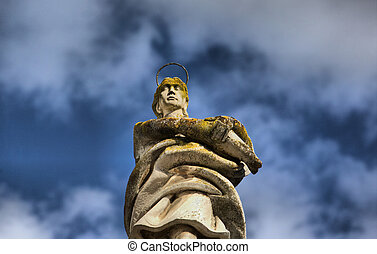 Angel over clouds - San Rafael Archangel statue on Potro...