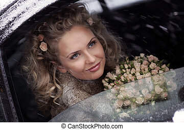 Bride smiling out of limo window