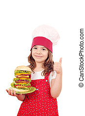 happy little girl cook with big hamburger and thumb up