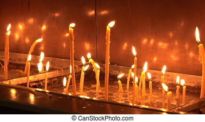 Candles in the Orthodox Church. 4K. - Candles in the...
