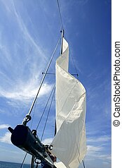 Sailor in sailboat rigging the sails