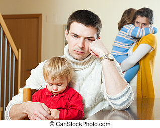 Young family with two  children having quarrel