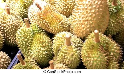 Asian fruits durian and pomelo on a market stall. HD....