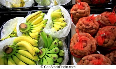 Asian fruits bananas, tamarind, pineapple on a market stall....