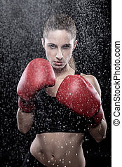 Beautiful woman wearing boxing gloves - Beautiful woman in...