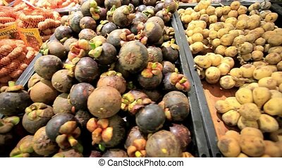 Asian fruits mangosteen, lychee, tamarind, rambutan on a...