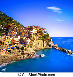 Manarola village, rocks and sea at sunset Cinque Terre,...
