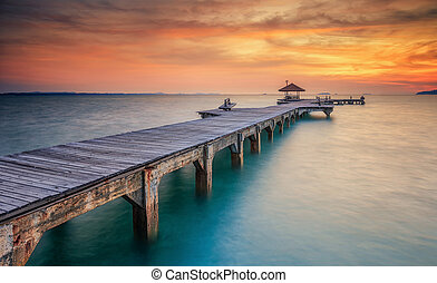 Wood bridge along sunset in island beach