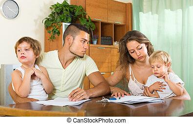 Parents with children having quarrel - Unpleasantness about...