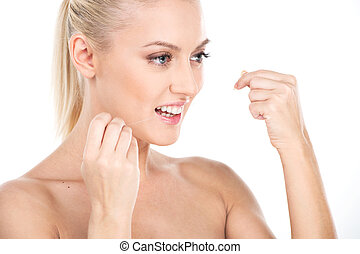 Beautiful young woman using dental floss, isolated on white. Woman flossing teeth, dental care