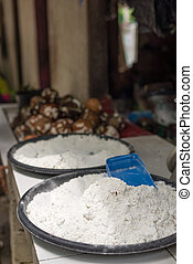 Coconut flour on sell in market - Selective focus on dry...