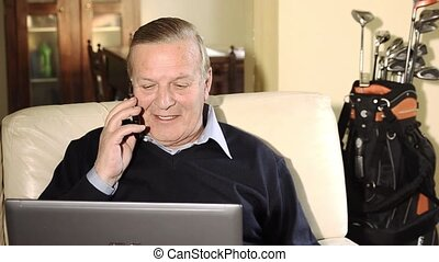 senior businessman working at home - Senior man with laptop...