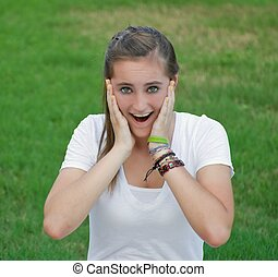 Happy Surprise - Pretty teen girl with braces showing...
