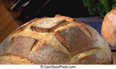Sourdough Loaf CU zoom - Zoom out from a CU of a round loaf...
