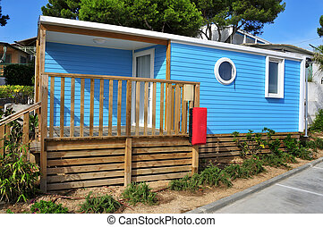 mobile home in a campsite - a nice blue mobile home with a...