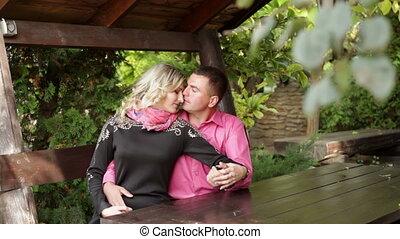 couple in love sitting in the gazebo