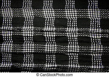 Black and white fabric in a cage - Checked fabric with a...