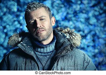 down jacket - Portrait of a handsome brutal man dressed in...