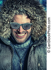 white teeth smile - Handsome brutal man dressed in winter...