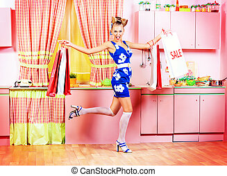 pin-up sale - Fashionable pin-up girl standing with shopping...