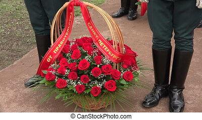 Basket with red roses. Shot in 4K (ultra-high definition...