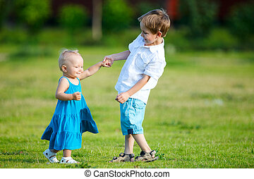 Siblings  - Brother and sister outdoors at sunny day