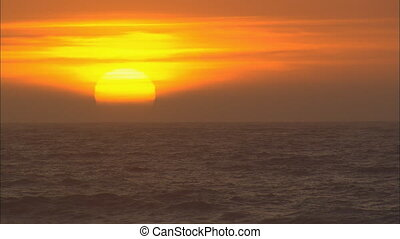 SunSettingOverOceanCU - CU of the sun setting over the...