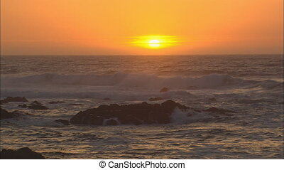 MS Sun Setting Over Ocean - WS of sun setting over the...