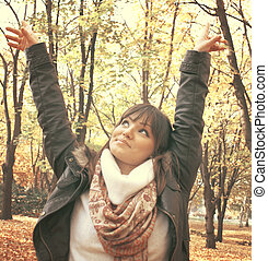 Portrait of a happy woman in autumn forest