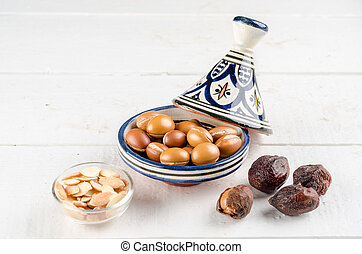 Argan fruit in a moroccan tajin - Argan Fruit on a wooden...