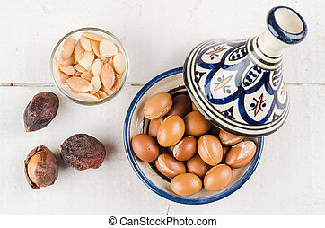 Argan fruit in a moroccan tajine - Argan Fruit on a wooden...