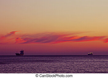 Sunset on sea with ships