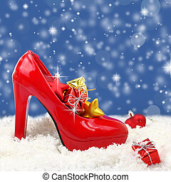 High heel shoe with christmas ornaments on snow