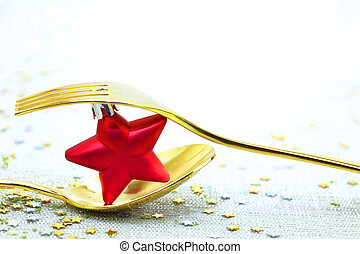 Christmas golden cutlery and on festive background -...