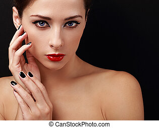 Beautiful female model with red lipstick and black nails...