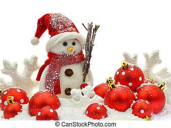 Snowman and Christmas ornaments on snow