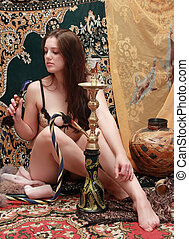sexy girl with hookah - attractive long-haired woman posing...