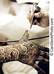 Applying Henna - A Hindu Bride has Henna applied to her...