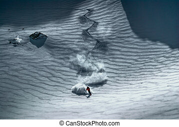 Male skier riding down the hill - Amazing view of a skier...