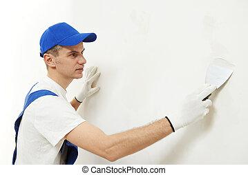 Plasterer at indoor wall work - male plasterer at indoor...