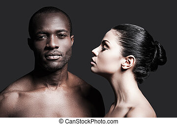 Black and white. Portrait of shirtless African man and...