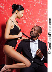 Unleashed desire Handsome young African man in formalwear...