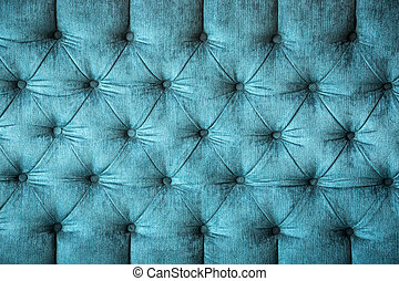 velvet texture - close up of a turquoise velvet sofa