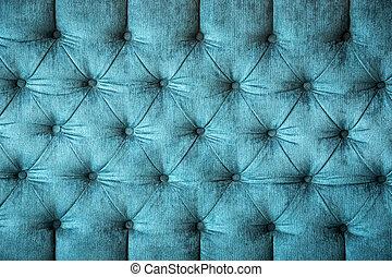 velvet texture - close up of a turquoise velvet sofa