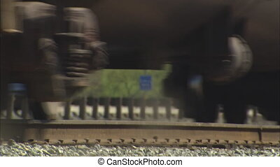 Train Goes Over Tracks tilt up - MS of train going over...