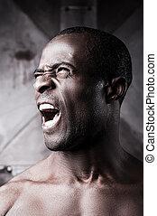 Furious man Portrait of furious young shirtless African man...